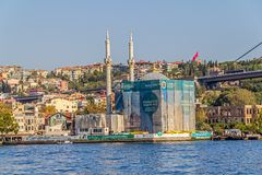 Ortakoy Mosque. ISTANBUL, TURKEY - SEPTEMBER 29, 2013: View of the Ortakoy Mosque in restoration and First Bosphorus Bridge, sailling Bosporus Stock Images