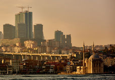Ortakoy mosque under bosphorus bridge in istanbul, turkey. Bosphorus bridge between asia and europe. Royalty Free Stock Images