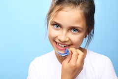Orthodontic appliance. Portrait of a little girl with orthodontic appliance Stock Images