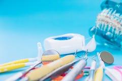 Dentist tools and orthodontic model. Orthodontic model and dentist tool - demonstration teeth model of varities of orthodontic bracket or brace stock photos