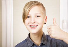 Orthodontics and bite correction. Teen with braces on his teeth. Orthodontics and bite correction Stock Photos