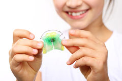 Orthodontics. Pretty girl with colored orthodontic appliance Stock Photos