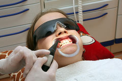 At the orthodontist. Preparation before insert a fixed brace Stock Images