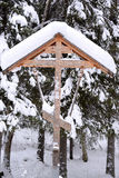 Orthodox antique handmade wooden cross in winter Stock Photos