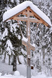 Orthodox antique handmade wooden cross in winter Stock Photography