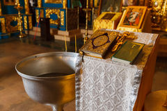 Orthodox baptism bowl of holy water and candles Stock Image