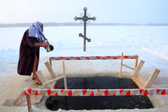 Orthodox believer takes a dip in ice cold water. Antoniyevo-Dymsky monastery, the Leningrad region, near St. Petersburg, Russia,- 19 January 2013. A Russian Royalty Free Stock Image