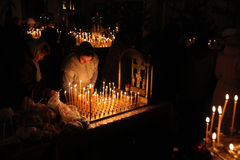 Orthodox believers light candles in Pskov, Russia. Royalty Free Stock Image