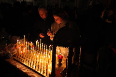 Orthodox believers light candles in Pskov, Russia. Stock Photography