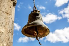 Orthodox bell closeup against the sky with clouds Royalty Free Stock Photo