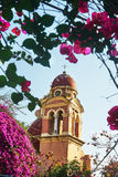 Orthodox bell tower with bougainvillea flower Royalty Free Stock Photography