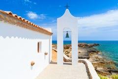 Orthodox bell tower, Zakynthos, Greece. Agios Nikolaos. Small white Orthodox bell tower arch near church. Coast of island Zakynthos, Greece Stock Photo