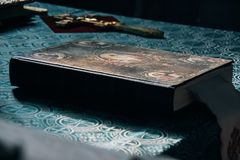 Bible and cross. Orthodox Bible and cross. Shallow depth of field. Focus on the the central part of the Bible stock images