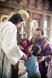 Orthodox bishop gives communion to a little boy. Orthodox liturgy with bishop Mercury in High Monastery of St Peter in Moscow on March 14, 2010 in Moscow Royalty Free Stock Photos
