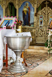 Orthodox bowl of holy water and candles for christening Stock Images