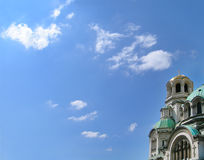 Orthodox cathedral against sky. Golden dome with a cross Royalty Free Stock Photos