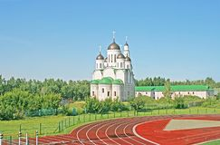 Orthodox cathedral in the background of sports stadium Royalty Free Stock Images