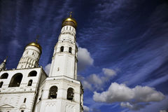 Orthodox Cathedral, Cobalt Sky, Kremlin, Moscow, Russia. A deep blue sky backs the pure white and golden domes of an Orthodox cathedral inside the grounds of the Stock Photography