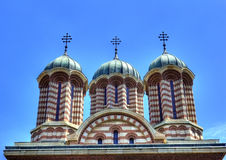 Orthodox cathedral domes. Architectural details of domed cathedral with blue sky background, Craiova city, Romania Royalty Free Stock Photo