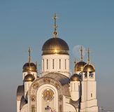 Orthodox cathedral and full moon. Orthodox cathedral with golden domes and full moon behind Royalty Free Stock Photography