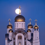 Orthodox cathedral and full moon. Orthodox cathedral with golden domes and full moon behind Stock Photo