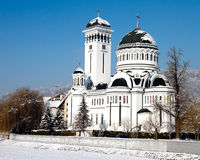 Orthodox cathedral with snow in Romania. Orthodox cathedral of Sighisoara. Situated on the Northern shore of the Tarnava Mare, dedicated to the Saint Trinity, is Stock Image