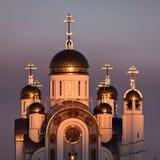Orthodox cathedral with sunset illumination. Orthodox cathedral with golden domes with sunset illumination Stock Images