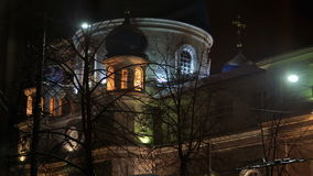 Orthodox cathedral in winter evening city stock video footage
