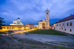 Orthodox and Catholic Cathedral in Alba Iulia. Orthodox and Catholic Cathedral in Alba Iulia at nightfall Stock Photography