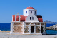 Orthodox chapel in Crete. Small Orthodox Chapel and Cretan Sea Turquoise Background Stock Images