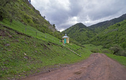 Orthodox chapel at the mountain road. Caucasus, Russia. Royalty Free Stock Images