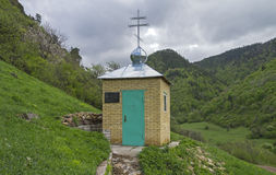 Orthodox chapel in the mountains.  Caucasus, Russia. Stock Image