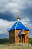 Orthodox chapel. The roof of the church, golden Orthodox cross Royalty Free Stock Photo