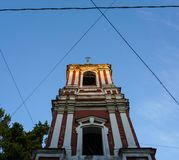 Orthodox chapel tower exterior within symmetrical cables stock image