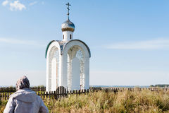 Orthodox chapel white with a transparent facade on the background of the panorama of the sea and blue sky in a field Stock Photography