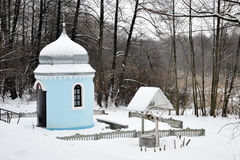Orthodox chapel in the winter woods. For your design Royalty Free Stock Photography