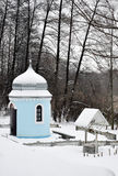 Orthodox chapel in the winter woods. For your design Stock Photos