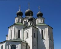 An Orthodox Christian Cathedral in white color with four black domes stock photography