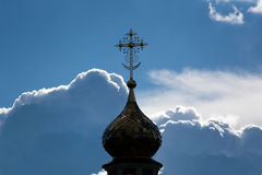 Orthodox Christian Cross. Orthodox cross against the background of clouds for the background Stock Image