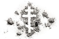 Orthodox christian cross or crucifix symbol. Made in ash, sand or dust as religion, lent, fasting, absinence concept Royalty Free Stock Photography