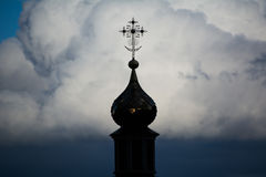 Orthodox Christian Cross. Photo of an Orthodox Christian cross on a background of gloomy clouds Royalty Free Stock Image