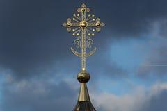 Orthodox Christian Cross. Yoshkar-Ola, Russia - April 25, 2017 Photo of an Orthodox Christian cross on a background of gloomy clouds Stock Image