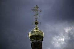 Orthodox Christian Cross. Yoshkar-Ola, Russia - May 1, 2017 Photo of an Orthodox Christian cross on a background of gloomy clouds Stock Photos
