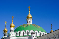 Orthodox Christian monastery, Pechersk Lavra in Kiev on green hi Stock Photos