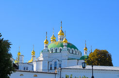Orthodox Christian monastery, Pechersk Lavra in Kiev on green hi Royalty Free Stock Photos