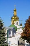 Orthodox Christian monastery, Pechersk Lavra in Kiev on green hi Stock Photography