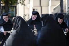 Orthodox Christian nuns at Saint Demetrius relics stock photography