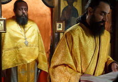 Orthodox christian priest monk during a prayer praying portrait Stock Images