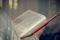 Orthodox christian priest reading church book Royalty Free Stock Photo