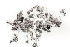 Orthodox christian religion cross or crucifix symbol made in ash. Orthodox christian cross or crucifix symbol made in ash, sand or dust as religion, lent, bible Royalty Free Stock Photography
